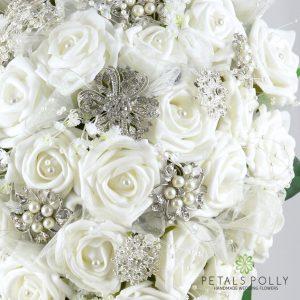 White foam rose diamante brooch brides teardrop bouquet