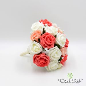 Orange coral, peach and ivory rose ranunculus bridesmaids posy