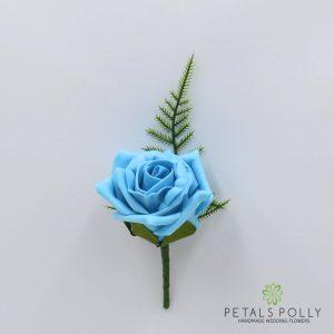 Turquoise foam rose buttonhole