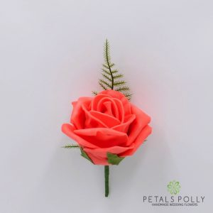 Orange coral foam rose buttonhole
