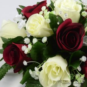 Artificial burgundy and ivory rose top table decoration