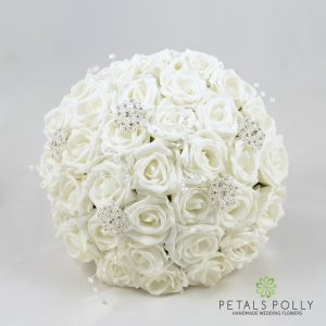 White foam rose brides bouquet with brooches