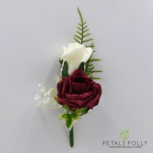 Burgundy and ivory double foam rose buttonhole