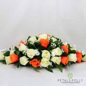 orange and ivory silk rose top table decoration arrangement