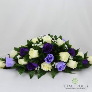 purple, lilac and ivory silk rose top table decoration arrangement