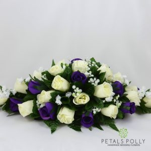 Artificial cadbury purple and ivory rose top table decoration
