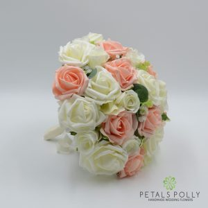 Peach ivory brides bouquet